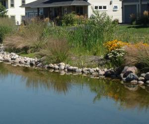 Shorelines will be sloped back and covered with rock and native vegitation.