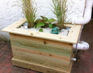 Downspout planters are a creative way to manage your roof water.