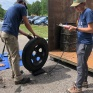 United by Blue staff weigh a tires from Yeader Creek