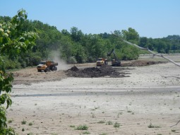 Hauling sediment from the lake to build a berm for the wetland