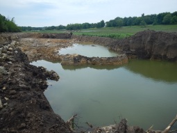Trucks removed 2-8 feet deep of sediment in this location.