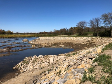 Riprap stabilization, a new jetty, and fish habitat rock pile