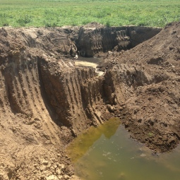 As can be seen here, a deep pool in the lake bed has been formed from sediment removal.